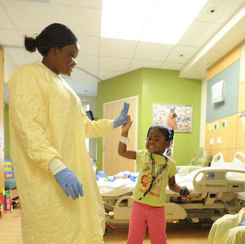 Doctor high-fiving child patient