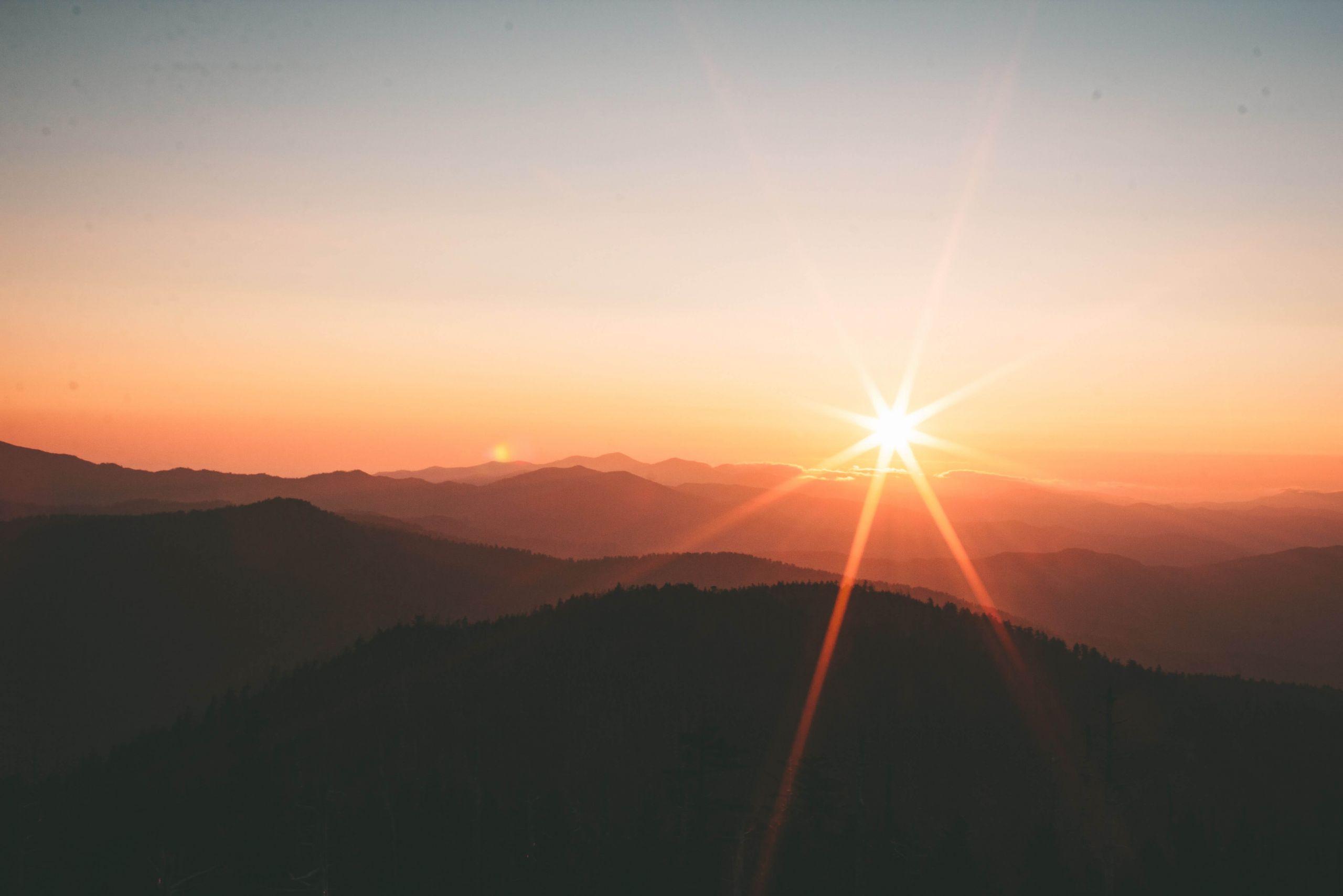 sun rising over mountain tops