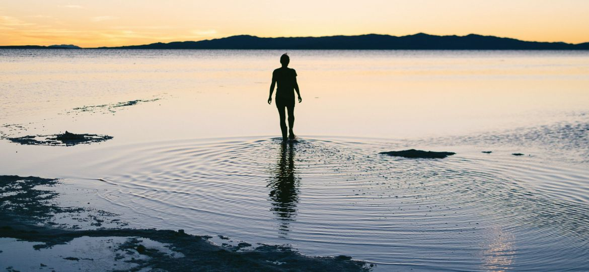 teen standing in lake water