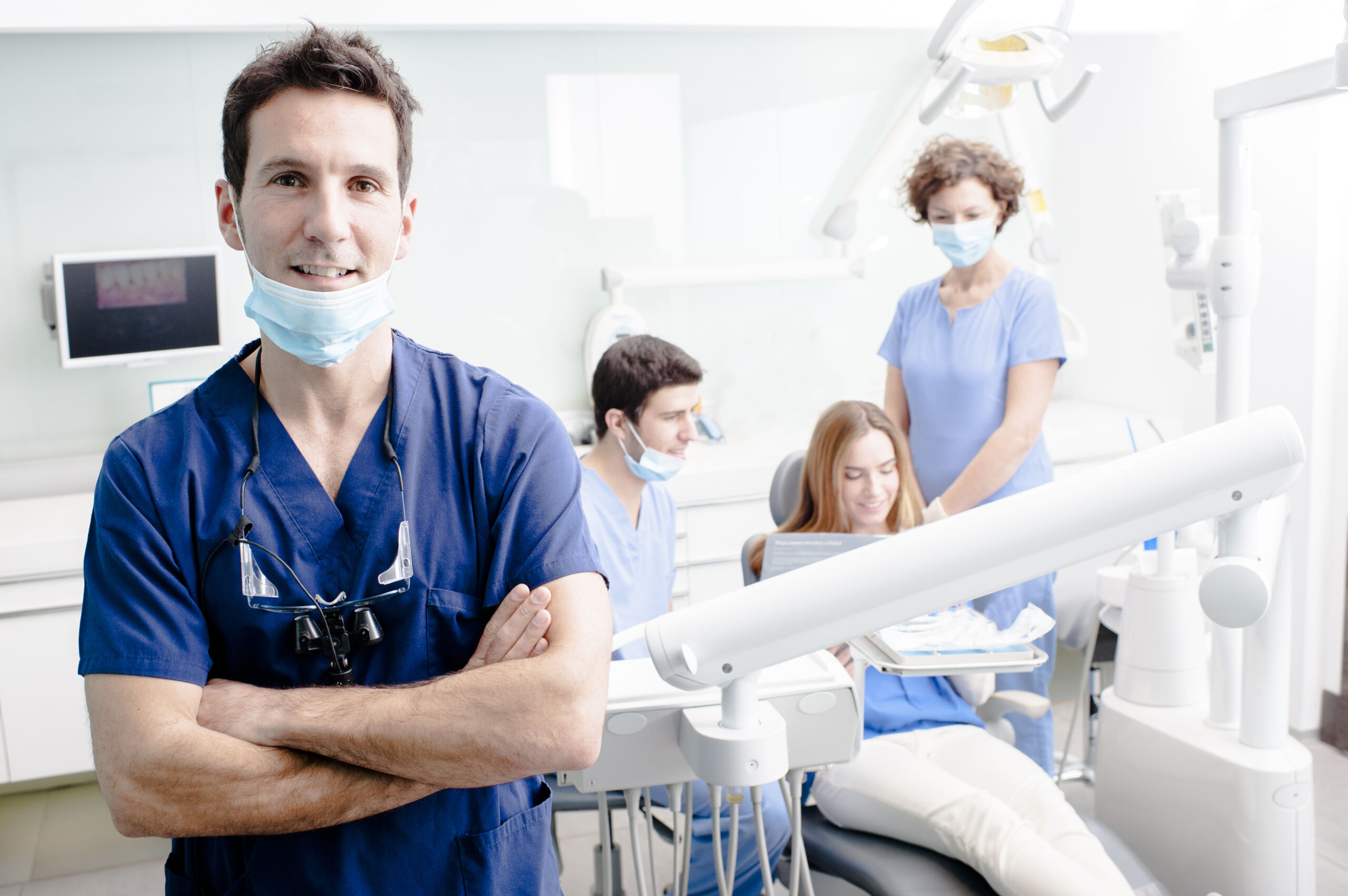 Dentist and Staff with Patient