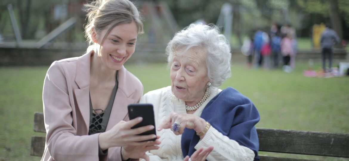 Woman sitting with elderly woman
